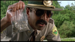 Cop Holding Drugs